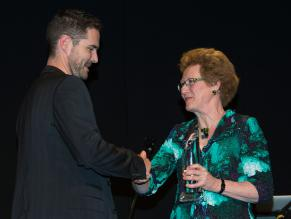 Alan Brannigan accepting award from Mary Quin